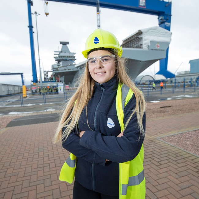 Woman standing in front of ship