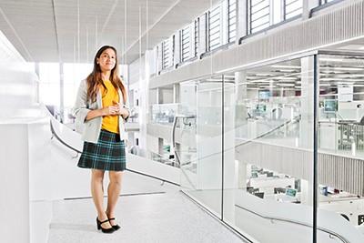 Photo of apprentice standing in modern office corridor
