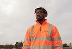A male apprentice in overalls