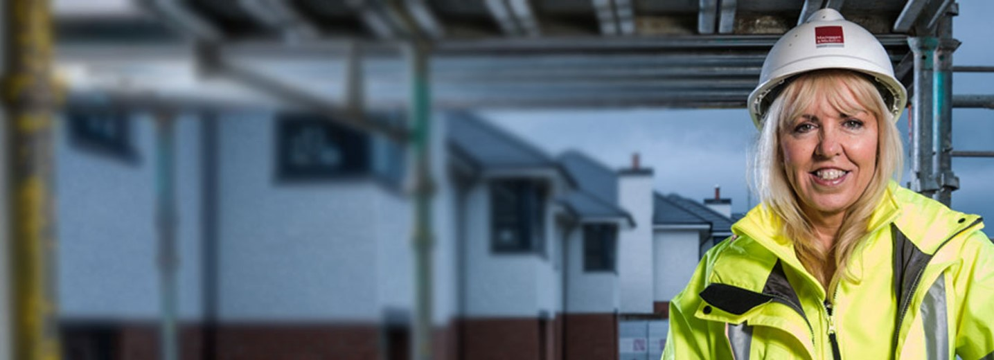 Scottish Power Head of Learning and Development Eileen Harper in a hard hat and high-vis jacket on a construction site
