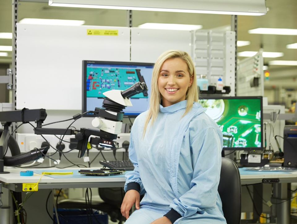 Woman sitting in science lab