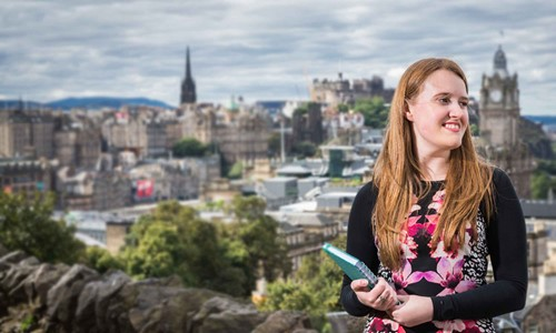 Female Modern Apprentice in tourism Rachel stands overlooking the city of Edinburgh