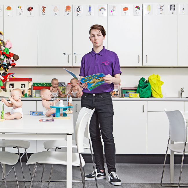 Young man standing in a nursery