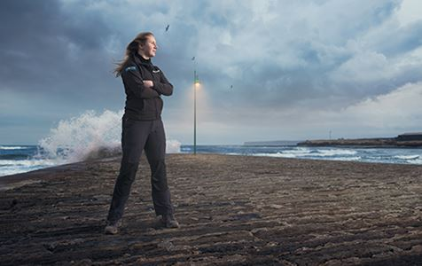 Graduate Level Apprentice Bethany stands at the sea front in Thurso