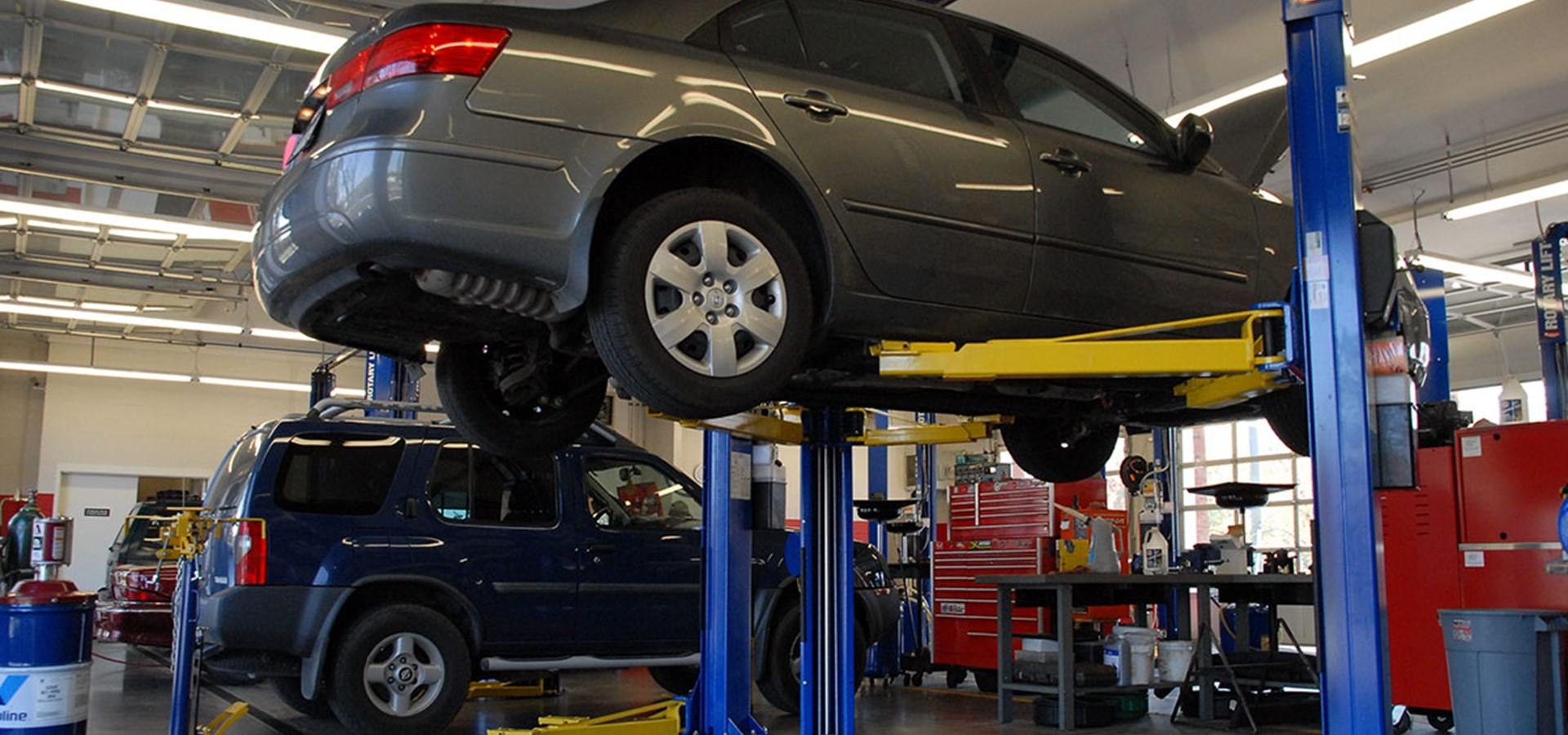 A car on a hoist in a garage