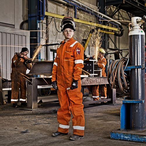 Young female welder apprentice